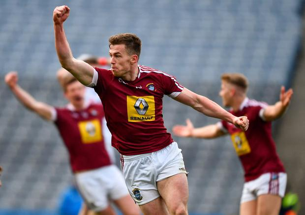 Evan O'Carroll of Westmeath, and team mates, celebrates scoring the only goal of the game. Photo: Ray McManus/Sportsfile