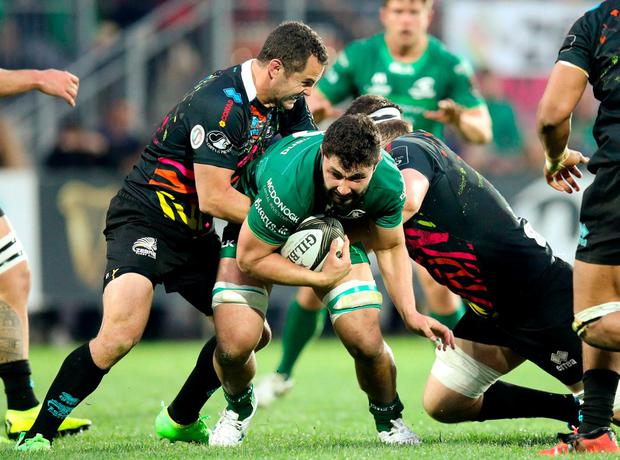 Colby Faingaa of Connacht is tackled by Francois Brummer, left, and Oliviero Fabiani of Zebre. Photo: Roberto Bregani/Sportsfile