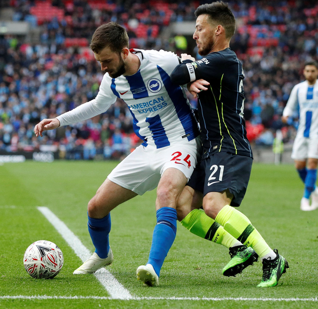 Brighton's Davy Propper in action with Manchester City's David Silva. Photo: Reuters/John Sibley