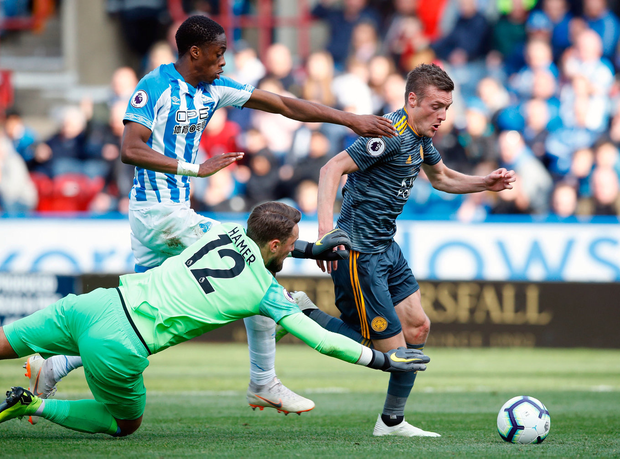 Leicester City's Jamie Vardy (right) is brought down inside the box by Huddersfield's Terence Kongolo, for a penalty. Photo: Martin Rickett/PA