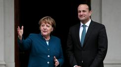 Leo Varadkar greeted Angela Merkel in Dublin. Photo: Brian Lawless/PA