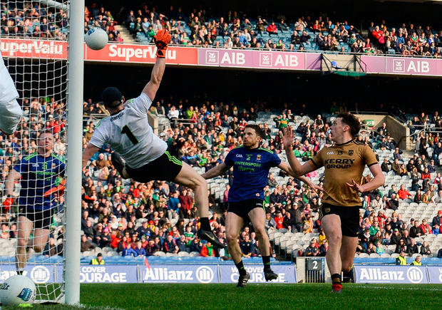 Mayo's Rob Hennelly makes a point-blank save from Kerry's David Clifford last Sunday — a stop that not only rescued Mayo in the league final but perhaps saved their season as well. Photo: Stephen McCarthy/Sportsfile