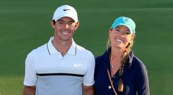 MAN OF THE MOMENT: Northern Ireland's Rory McIlroy poses with Erica Stoll, now his wife, and the World Tour Championship trophy in Dubai after he clinched his one-shot win in the final round of the 2015 contest. Photo: David Cannon, Getty Images