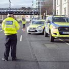 TESTING TIMES: Gardai set up a roadblock to check for drink-drivers at Custom House, Dublin. Photo: Tony Gavin
