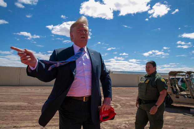 President Donald Trump speaks as he visits a new section of the border wall with Mexico in Calexico, California. Photo: Jacquelyn Martin/AP