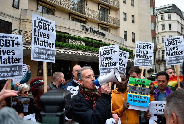 A VOICE TO BE HEARD: Human-rights campaigner Peter Tatchell addresses placard-waving protesters outside The Dorchester in Park Lane, London, yesterday in a noisy response to Brunei's new hardline stance against gay sex, which can include brutal death by stoning. Photo: Sophie Hogan, PA