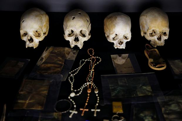 Sculls and personal items of victims of the Rwandan genocide are seen as part of a display at the Genocide Memorial in Gisozi in Kigali, Rwanda April 6, 2019.REUTERS/Baz Ratner