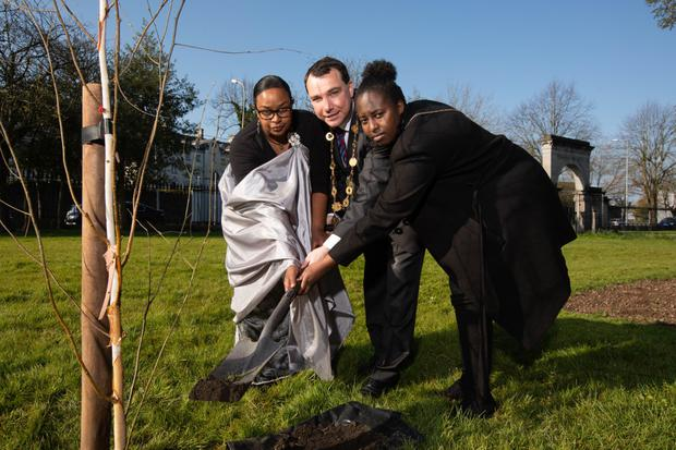 Chantal Mutesi and Egwyge Roussard joined by Mayor of the City and Council of Limerick James Collins.