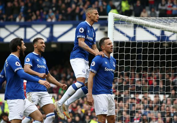 Phil Jagielka of Everton celebrates with team mates after scoring his team's first goal during the Premier League match between Everton FC and Arsenal FC (Photo by Jan Kruger/Getty Images)
