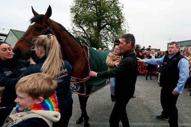 2019 Grand National Winner Tiger Roll with connections including jockey Davy Russell and his son Finn (3) and trainer Gordon Elliott (right) during the parade through Summerhill, County Meath, Ireland. Photo: Brian Lawless/PA Wire