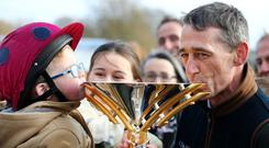 Grand National winner Tiger Roll homecoming Summerhill. Winning Jockey Davy Russell with his son Finn (3), daughter Jamie (15) and the Grand National Trophy. Photo: Gerry Mooney