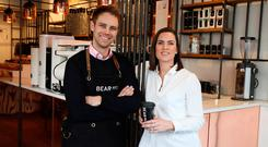 Dealing the cards: Husband and wife team Stephen and Ruth Deasy, of Bear Market Coffee, where customers cannot pay with cash. Photo: PA