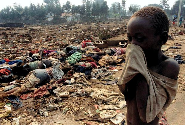 Lest we forget: A Rwandan boy covers his face from the stench of dead bodies in this 1994 file photo. REUTERS