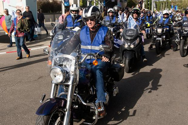 On wheels: Opposition leader Benny Gantz leads a motorcycle cavalcade as he campaigns in Tel Aviv ahead of tomorrow's poll. Photo: Amir Levy/Getty Images