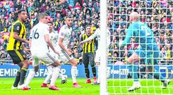 Sting in the tail: Watford's Gerard Deulofeu chips the ball into the top corner to spark an unlikely revival in yesterday's FA Cup semi-final victory against Wolves. Photo: Reuters