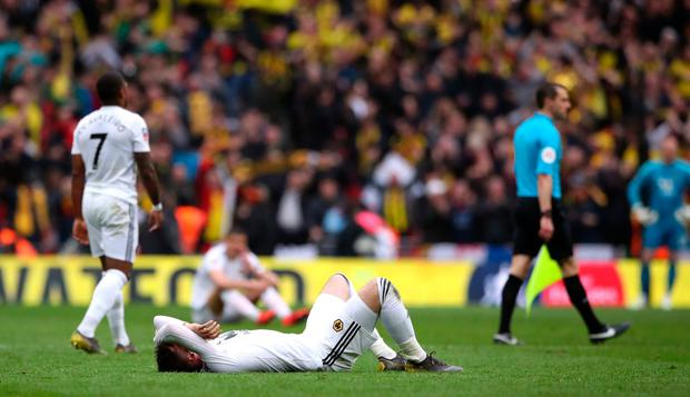 Wolverhampton Wanderers players appear dejected after the match. Photo: PA