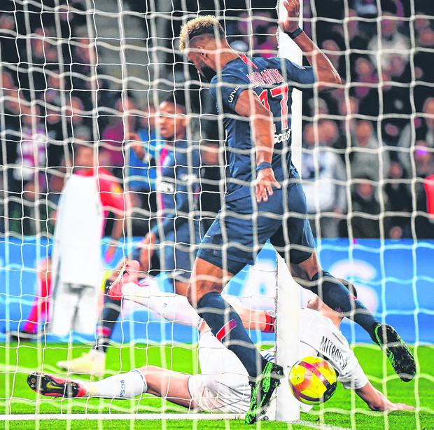 PSG's Eric Choupo-Moting blocks the ball from crossing the Strasbourg goal-line and then fails to score during last night's match at Parc des Princes. Photo: AFP/Getty Images