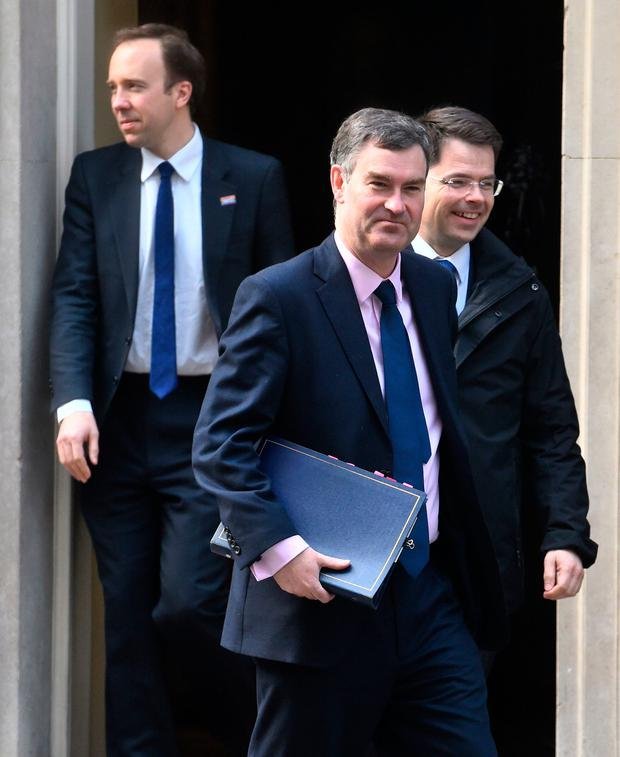 Britain's Justice Secretary David Gauke (front, centre), Housing, Communities and Local Government Secretary James Brokenshire (rear, right) and Health and Social Care Secretary Matt Hancock (left) leave 10 Downing Street, London. Kirsty O'Connor/PA Wire