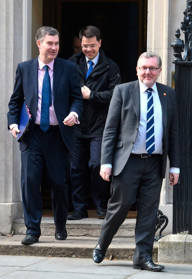 Britain's Justice Secretary David Gauke (left), Housing, Communities and Local Government Secretary James Brokenshire (centre) and Scottish Secretary David Mundell (right) leave 10 Downing Street, London. Kirsty O'Connor/PA Wire