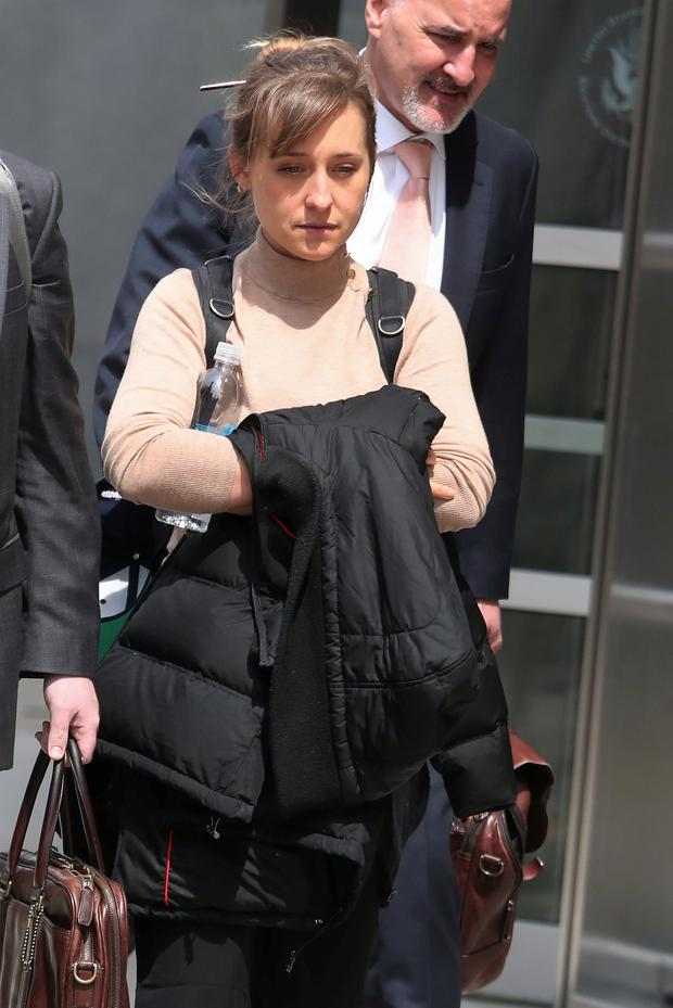 Actress Allison Mack departs the Brooklyn Federal Courthouse after facing charges regarding sex trafficking and racketeering related to the Nxivm cult case in New York, U.S., April 8, 2019. REUTERS/Shannon Stapleton