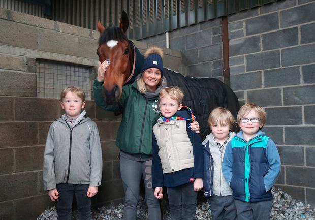 Proud mother: Louise Magee and her two sets of twin sons, eight-year-olds Thomas and Andrew and six-year-olds Michael and Kieran, with Tiger Roll. Photo: John Grossick/The Jockey Club
