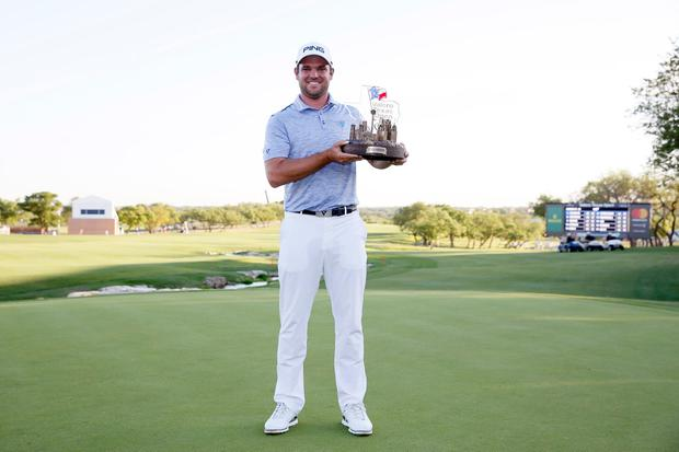 Corey Conners poses for a photo after winning the final round of the Valero Texas Open golf tournament at TPC San Antonio. Photo: Soobum Im-USA TODAY Sports