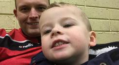 Fighter: Zac Higgins (2), with his dad Paul, was placed in a medically induced coma after the accident near his Cork home