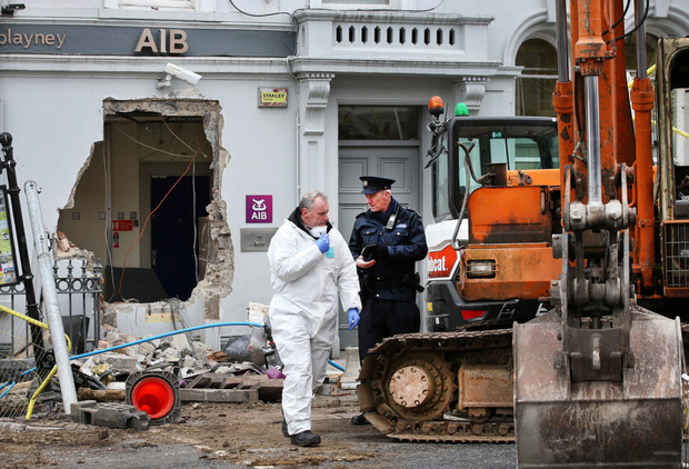 Cash grab: Gardaí at the scene of the ATM raid in Castleblayney last week. PHOTO: STEVE HUMPHREYS
