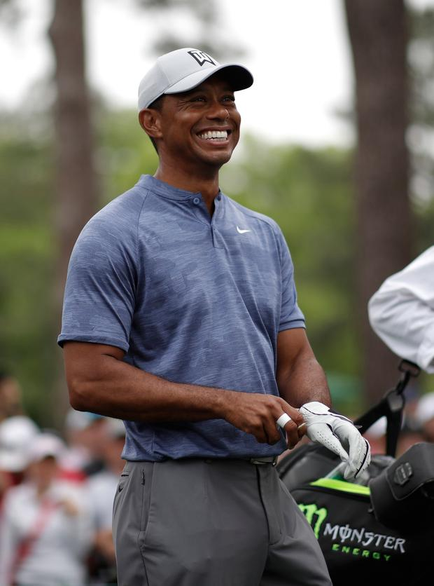 Tiger Woods of the U.S. smiles on the 17th tee during practice for the 2019 Masters golf tournament at the Augusta National Golf Club in Augusta. REUTERS/Mike Segar