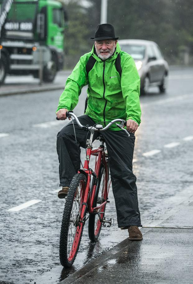 Dodging the traffic: Liam Collins has been cycling for 40 years. Photo: Kyran O'Brien
