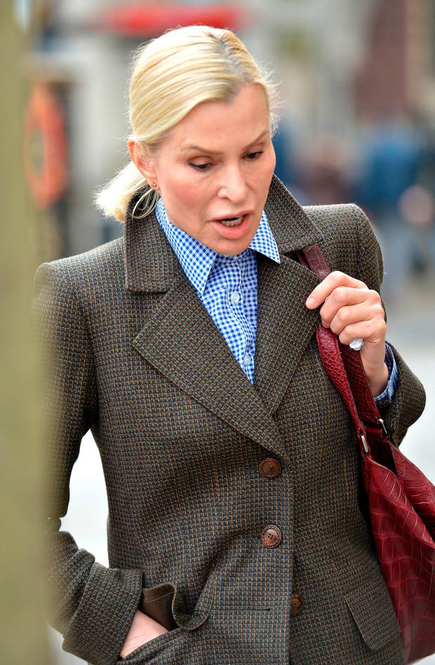 Clarissa Pierburg leaves the Royal Courts of Justice where she is embroiled in a London divorce fight with her estranged husband German businessman Jurgen Pierburg after he had an affair. Nick Ansell/PA Wire