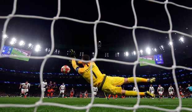 A Spur for the team: Tottenham's Hugo Lloris saves a penalty from Manchester City's Sergio Aguero at Wembley last night. Photo: PA