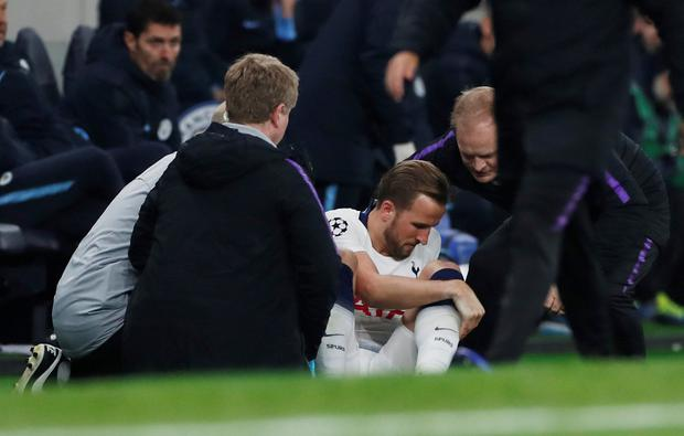 Tottenham's Harry Kane receives medical attention after sustaining an injury. Photo: Action Images via Reuters