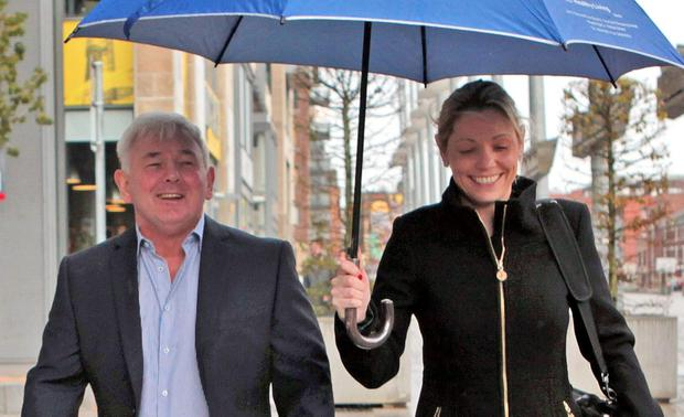Ex-client: Joanne Kangley with gang boss John Gilligan in 2013. Photo: Collins