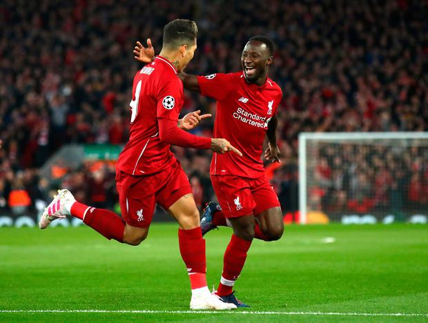 Naby Keita of Liverpool celebrates with Roberto Firmino after scoring his team's first goal. Photo: Getty