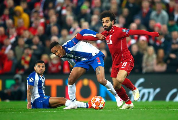 Eder Militao of FC Porto is challenged by Mohamed Salah. Photo: Getty