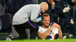 Harry Kane of Tottenham Hotspur receives treatment during the UEFA Champions League Quarter Final first leg match between Tottenham Hotspur and Manchester City at Tottenham Hotspur Stadium (Photo by Chris Brunskill/Fantasista/Getty Images)
