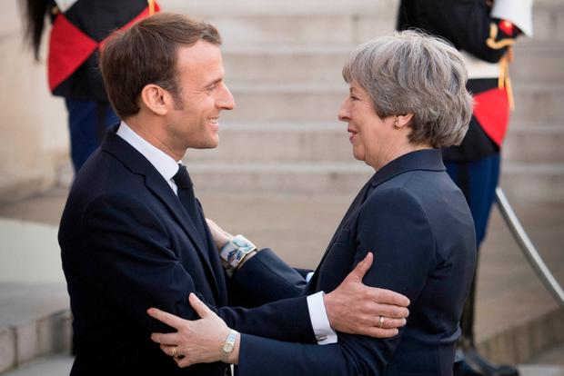 Holding their ground: British Prime Minister Theresa May with French President Emmanuel Macron after Brexit talks at the Élysée Palace in Paris. Photo: PA