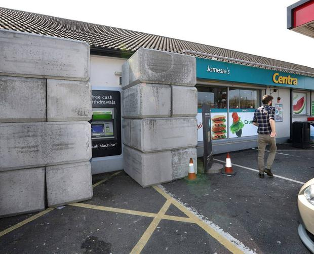 Concrete blocks stacked beside an ATM machine at a Centra store near Maghera