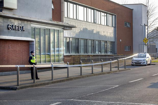 Probe: A garda on duty outside Finglas garda station after the incident. Photo: Tony Gavin