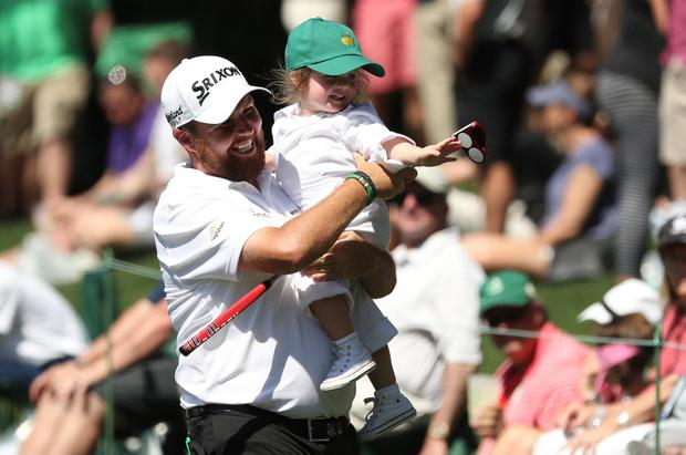 Shoulder high: Shane Lowry carries his daughter Iris during the Par 3 contest ahead of the Masters at Augusta. Photo: REUTERS/Jonathan Ernst
