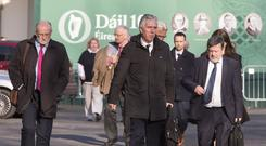 John Delaney with FAI Officials pictured leaving Leinster House after the PAC hearing. Photo: Colin O'Riordan