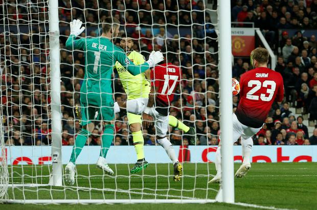 Luis Suarez's header hit off Manchester United's Luke Shaw to gift Barcelona a goal. Photo: REUTERS/Andrew Yates