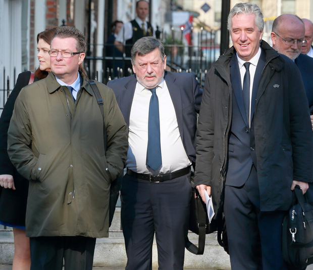FAI executive vice president John Delaney (right) arrives for the meeting with Donal Conway (centre) and Director of Communications Cathal Dervan