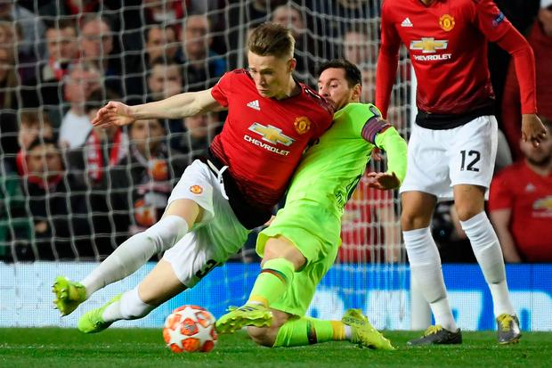 Manchester United's Scott McTominay (L) vies for possession with Barcelona's Lionel Messi. (Photo by LLUIS GENE / AFP)LLUIS GENE/AFP/Getty Images