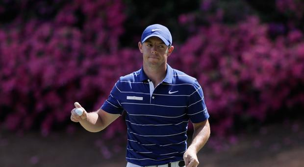 Rory McIlroy falters on final two holes as Tiger Woods puts himself in contention at Masters