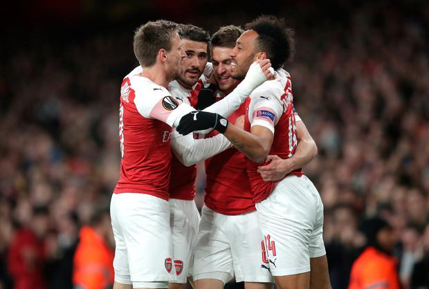 Arsenal's Aaron Ramsey (second right) celebrates scoring his side's first goal
