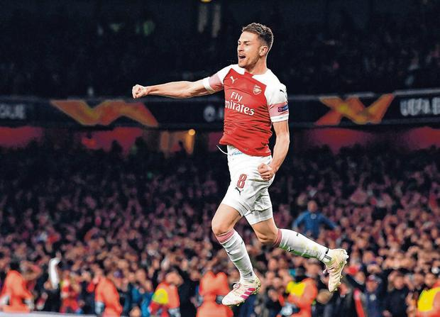 Aaron Ramsey celebrates after scoring Arsenal's first goal against Napoli at the Emirates Stadium last night. Photo: Ben Stansall/AFP/Getty Images