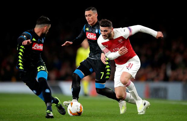 Arsenal's Sead Kolasinac (right) and a Napoli's Elseid Hysaj (left) and Jose Maria Callejon battle for the ball. Photo: Adam Davy/PA Wire