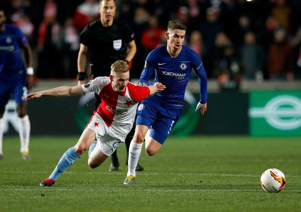 Chelsea's Jorginho, right, battles for the ball with Slavia Prague's Petr Sevcik. Photo: David Josek/AP Photo